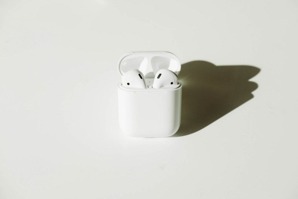 white wireless Bluetooth earbuds with case
