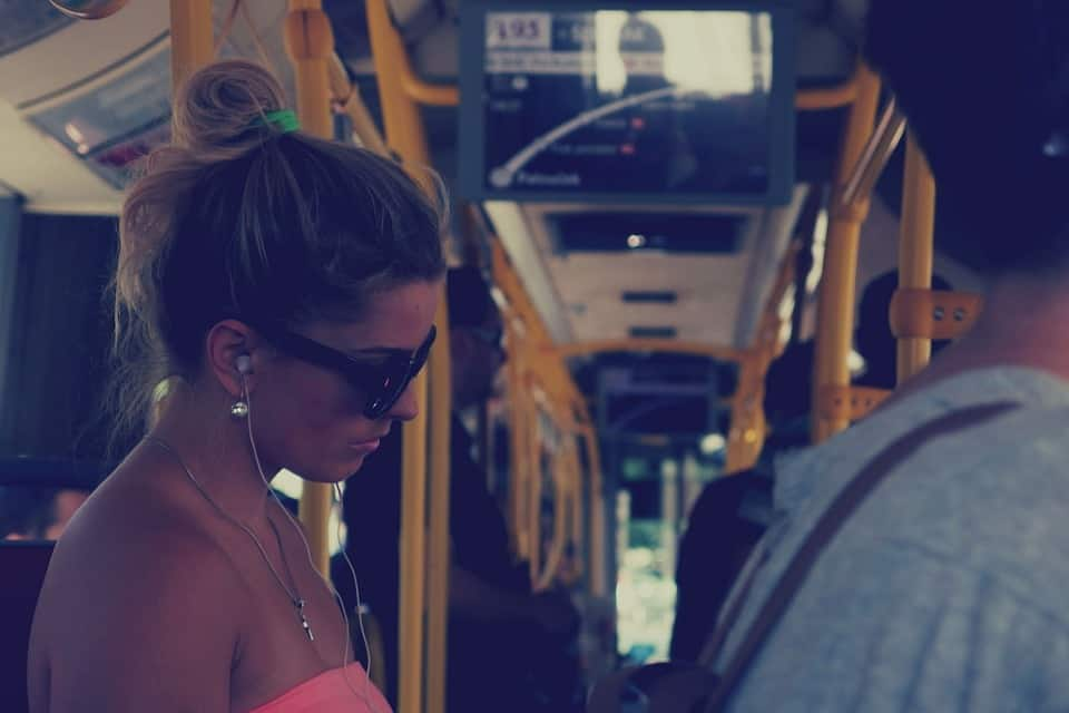 woman listening to music in bus